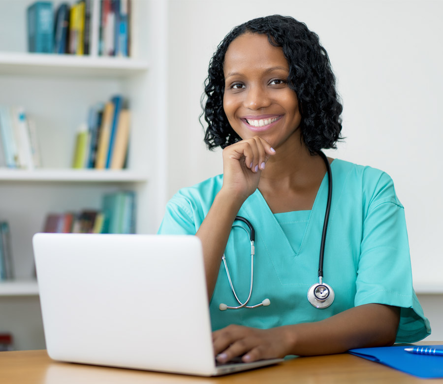 Nurse Studying with Laptop